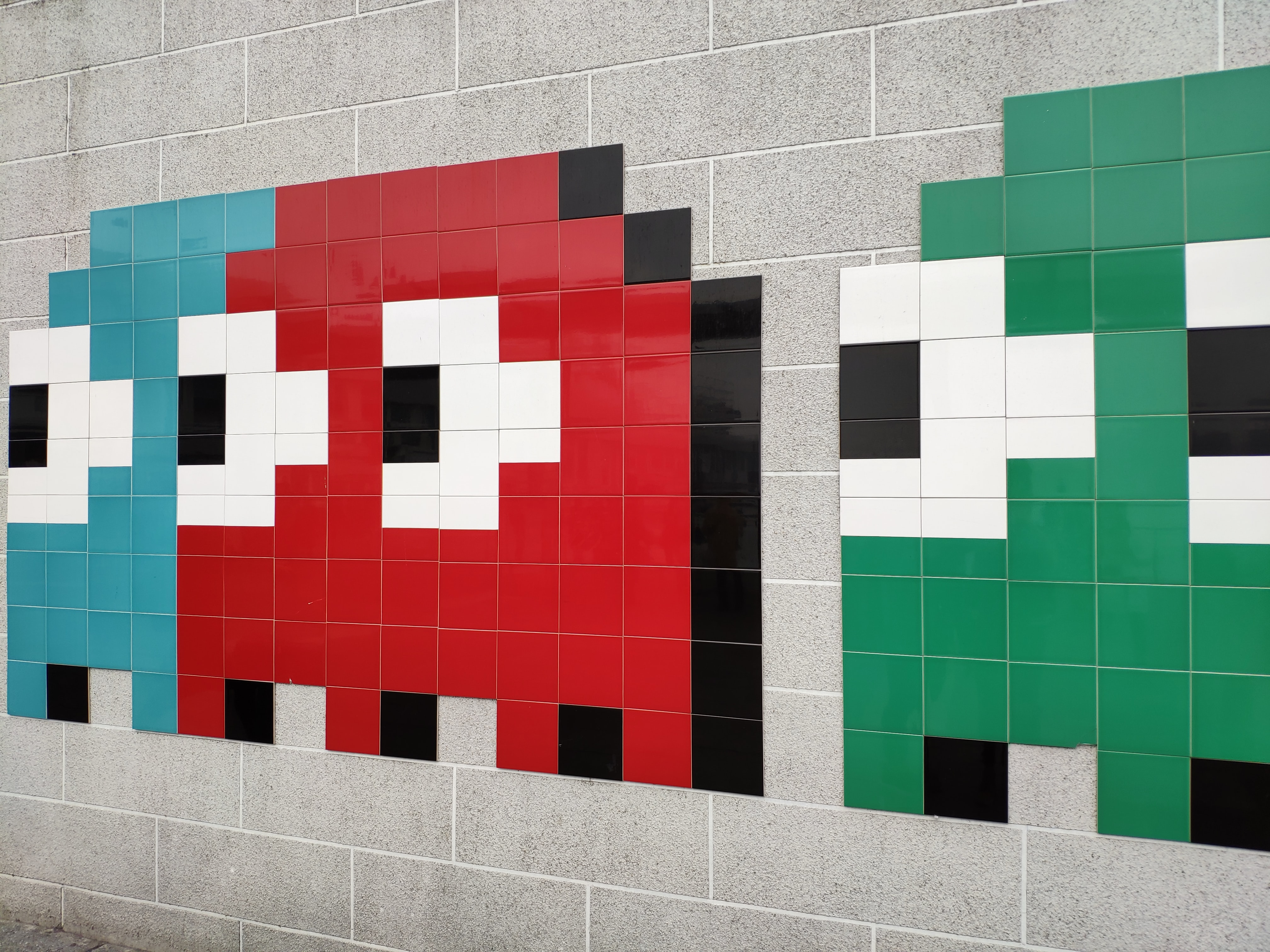 Pacman monsters on a grey wall